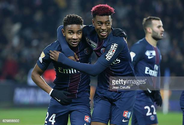 Christopher Nkunku and Presnel Kimpembe celebrate the goal of Lucas Moura during the French League Cup match between Paris SaintGermain and Lille OSC...