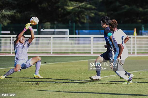 Christopher Nkunku of France and Ryosuke Kojima goalkeeper of Japan during the international friendly u20 match between France and Japan at Centre...