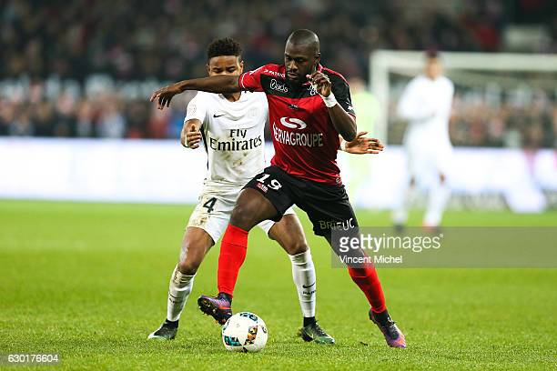 Christopher Nkunku of Paris Saint Germain and Yannis Salibur of Guingamp during the French Ligue 1 match between Guingamp and Paris Saint Germain at...
