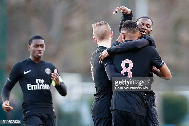 Christopher Nkunku of PSG celebrates with team mates after he scores his teams third goal during the UEFA Youth League Quarterfinal match between...