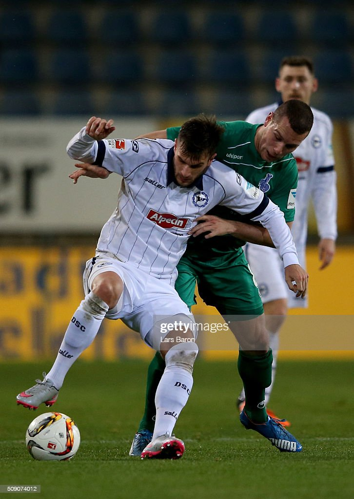 Christopher Noethe of Bielefeld is challenged by Thomas Broecker of Duisburg during the Second Bundesliga match between Arminia Bielefeld and MSV Duisburg at Schueco Arena on February 8, 2016 in Bielefeld, Germany.