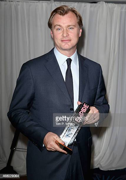 Christopher Nolan wins the Best Director Award during the Jameson Empire Awards 2015 at the Grosvenor House Hotel on March 29 2015 in London England