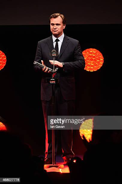 Christopher Nolan wins the Empire Inspiration Award on stage during the Jameson Empire Awards 2015 at the Grosvenor House Hotel on March 29 2015 in...