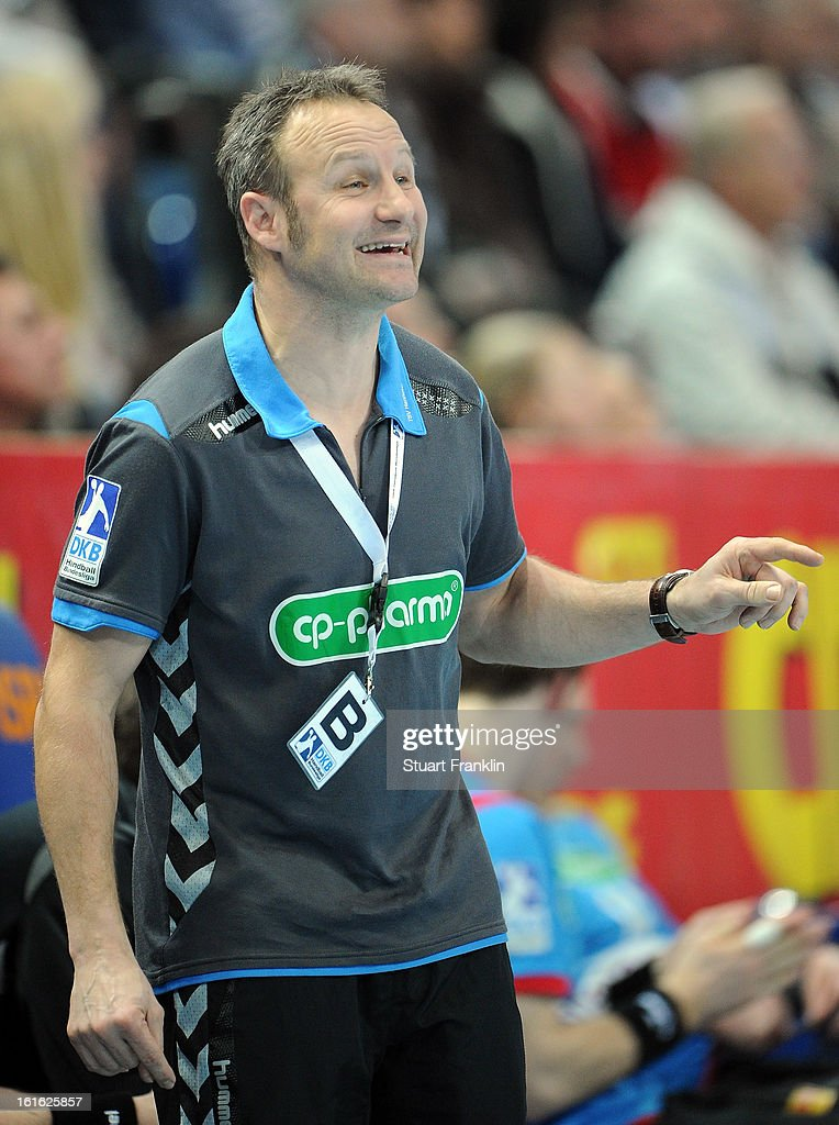 Christopher Nordmeyer, head coach of Hannover ponders during the HBL Bundesliga game between THW Kiel and TSV Hannover-Burgdorf at the Sparkassen arena on February 13, 2013 in Kiel, Germany.