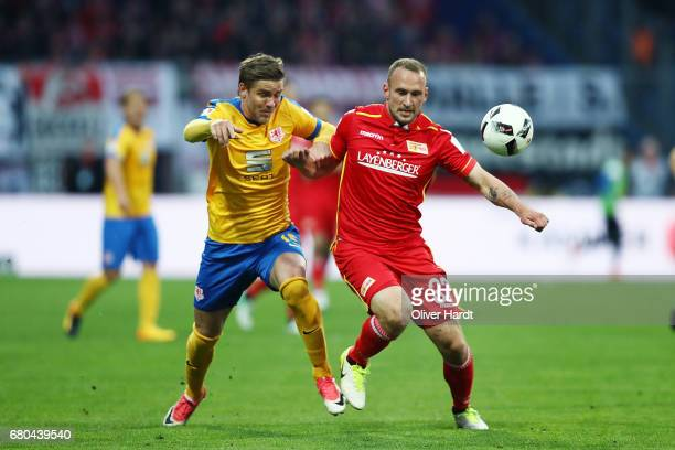 Christopher Nyman of Braunschweig and Toni Leistner of Berlin compete for the ball during the Second Bundesliga match between Eintracht Braunschweig...