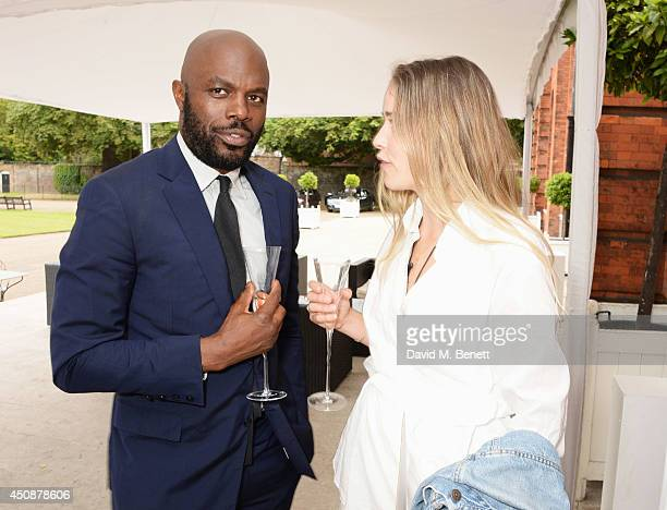 Christopher Obi and Maddison Brudenell attend the drinks reception hosted by Dockers the San Francisco based apparel brand at Kensington Palace on...