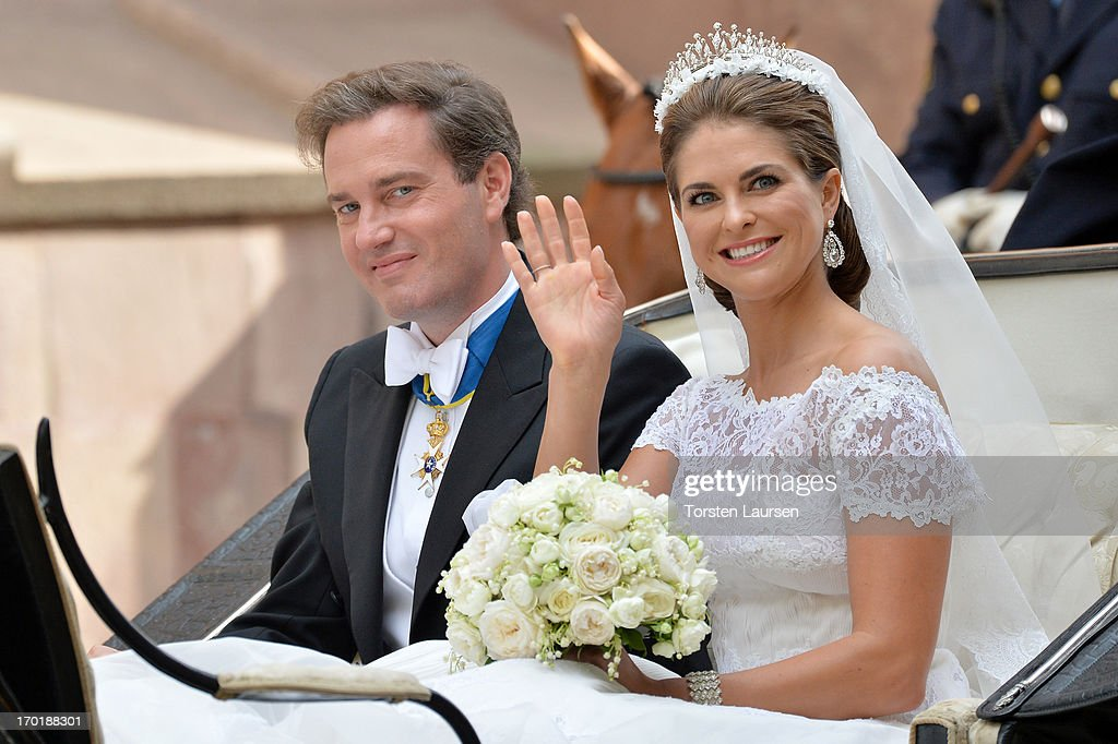 <a gi-track='captionPersonalityLinkClicked' href=/galleries/search?phrase=Christopher+O%27Neill&family=editorial&specificpeople=7470611 ng-click='$event.stopPropagation()'>Christopher O'Neill</a> and Princess Madeleine of Sweden are taken by horse and carriage from the Royal Palace of Stockholm to Riddarholmen after the wedding of Princess Madeleine of Sweden and <a gi-track='captionPersonalityLinkClicked' href=/galleries/search?phrase=Christopher+O%27Neill&family=editorial&specificpeople=7470611 ng-click='$event.stopPropagation()'>Christopher O'Neill</a> hosted by King Carl Gustaf XIV and Queen Silvia at The Royal Palace on June 8, 2013 in Stockholm, Sweden.