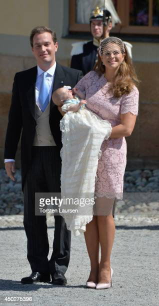 Christopher O'Neill and Princess Madeleine of Sweden carry their daughter Princess Leonore Duchess of Gotland after her Royal Christening at...
