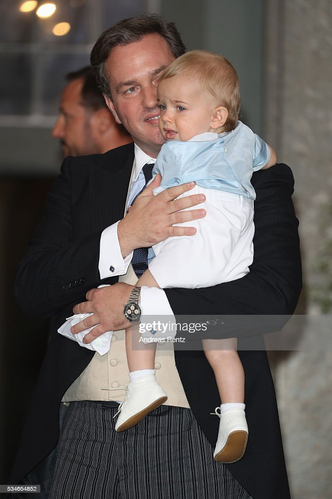 <a gi-track='captionPersonalityLinkClicked' href=/galleries/search?phrase=Christopher+O%27Neill&family=editorial&specificpeople=7470611 ng-click='$event.stopPropagation()'>Christopher O'Neill</a> holds his son Prince Nicolas of Sweden are seen after the christening of Prince Oscar of Sweden at Royal Palace of Stockholm on May 27, 2016 in Stockholm, Sweden.