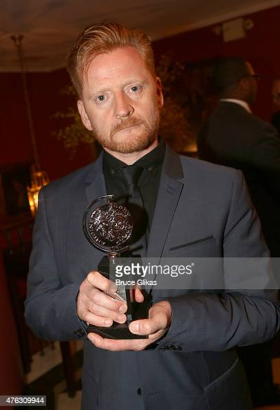 """Christopher Oram winner of the award for Best Costume Design of a Play for """"Wolf Hall Parts One Two"""" poses in the press room at the American Theatre..."""