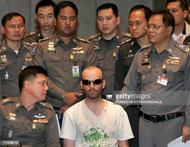 Christopher Paul Neil suspected Canadian paedophile and nicknamed 'Vico' by Interpol is surrounded by Thai policemen during a press conference at the...