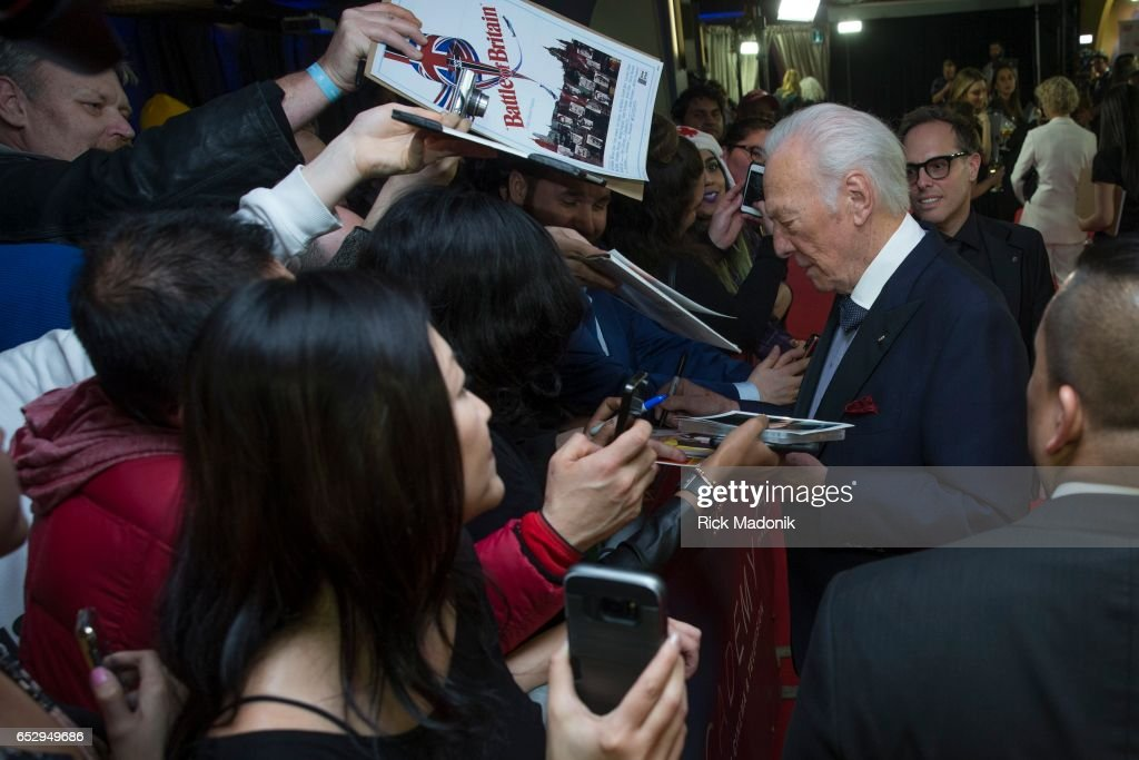 Christopher Plummer signs autographs for a few lucky fans near the red carpet. Canadian Screen Awards red carpet at Sony Centre for the Performing Arts ahead of the show.