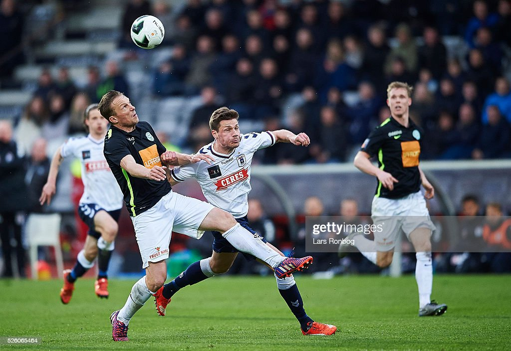 Christopher Poulsen of Viborg FF and Stephan Petersen of AGF Aarhus compete for the ball during the Danish Alka Superliga match between AGF Aarhus and Viborg FF at Ceres Park on April 29, 2016 in Aarhus, Denmark.