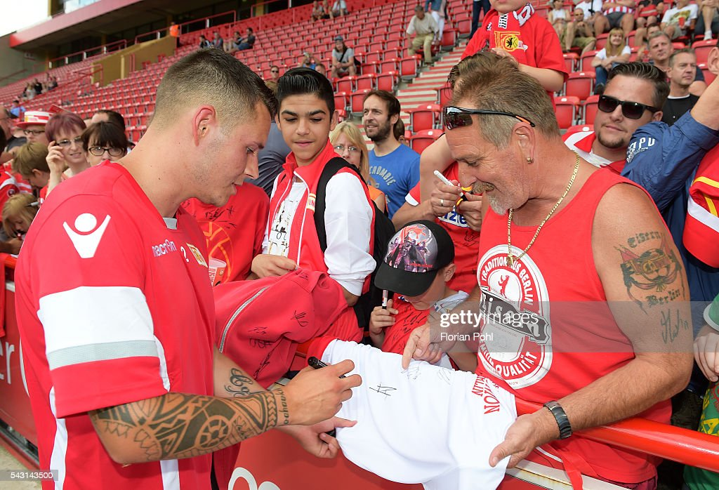 Christopher Quiring of 1.FC Union Berlin signs autographs during training on June 26, 2016 in Berlin, Germany.