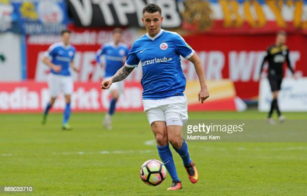 Christopher Quiring of Rostock runs with the ball during the third league match between FC Hansa Rostock and 1FC Magdeburg at Ostseestadion on April...