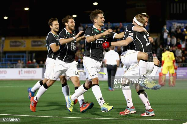 Christopher Ruhr of Germany celebrates scoring the winning the penalty with his team mates during the semifinal match between Spain and Germany on...