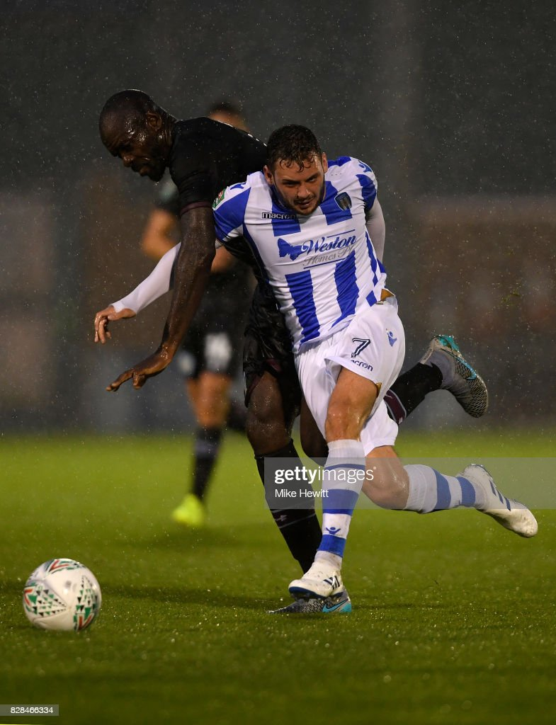 Christopher Samba of Aston Villa challenges Drey Wright of Colchester during the Carabao Cup First Round match between Colchester United and Aston Villa at Colchester Community Stadium on August 9, 2017 in Colchester, England.