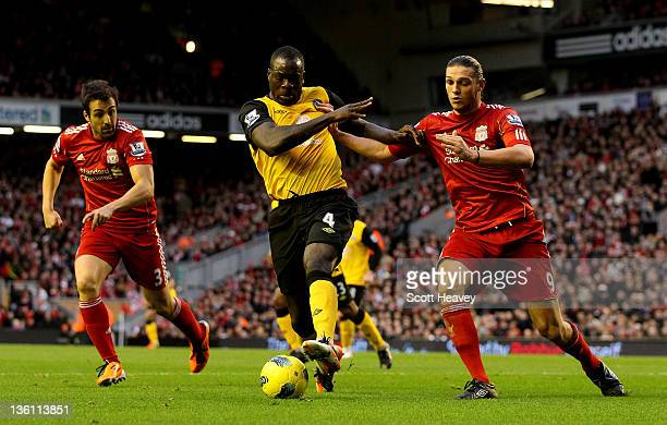 Christopher Samba of Blackburn in action with Andy Carroll of Liverpool during the Barclays Premier League match between Liverpool and Blackburn...