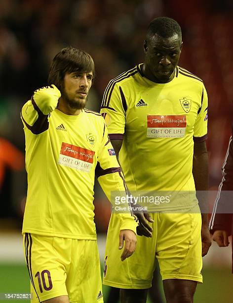 Christopher Samba of FC Anji Makhachkala and Shamil Lahiyalov look dejected at the end of the UEFA Europa League Group A match between Liverpool FC...
