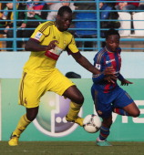 Christopher Samba of FC Anzhi Makhachkala battles for the ball with Ahmed Musa of PFC CSKA Moscow during the Russian Premier League match between FC...