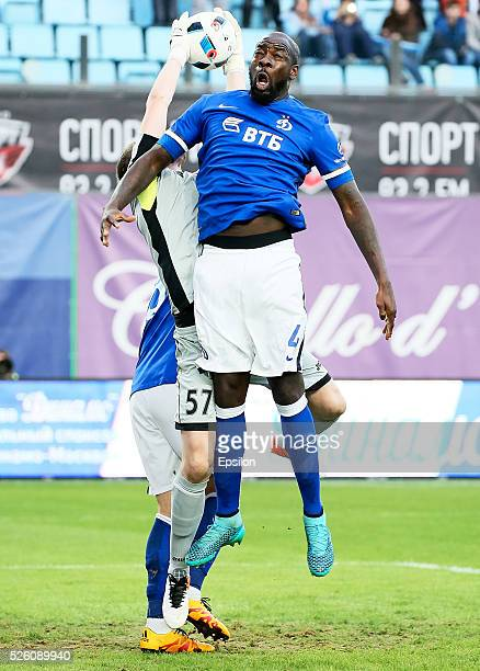 Christopher Samba of FC Dinamo Moscow and goalkeeper Aleksandr Selikhov of FC Amkar Perm vie for the ball during the Russian Football League match...