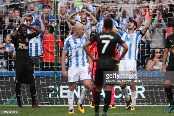 Christopher Schindler of Huddersfield Town celebrates at full time during the Premier League match between Huddersfield Town and Newcastle United at...