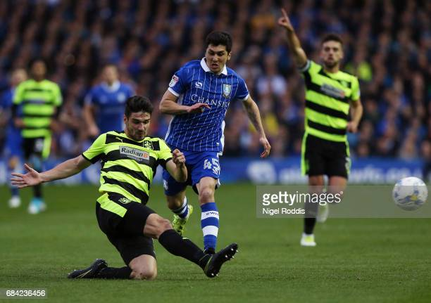 Christopher Schindler of Huddersfield Town clears the ball while under pressure from Fernando Forestieri of Sheffield Wednesday during the Sky Bet...