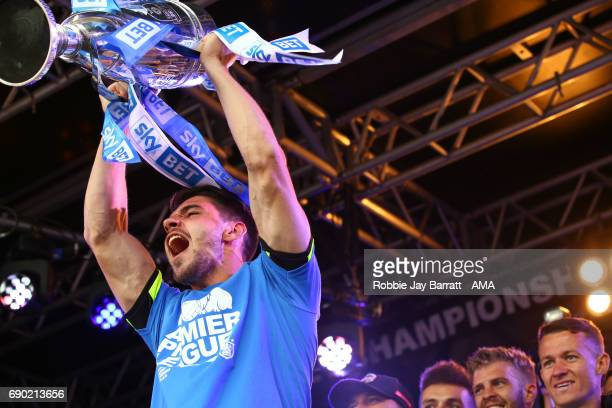 Christopher Schindler of Huddersfield Town lifts the Sky Bet Championship Play offs trophy on May 30 2017 in Huddersfield England