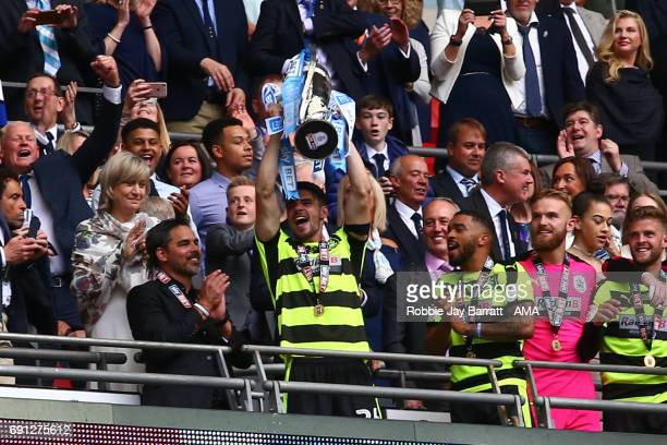 Christopher Schindler of Huddersfield Town lifts the Sky Bet Championship play offs trophy during the Sky Bet Championship Play Off Final match...