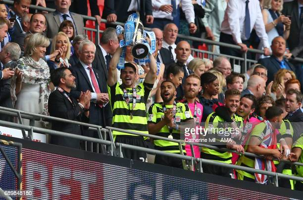 Christopher Schindler of Huddersfield Town lifts the trophy after the Sky Bet Championship Play Off Final match between Reading and Huddersfield Town...