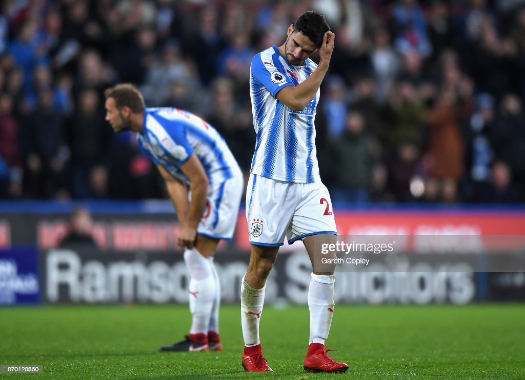 Christopher Schindler of Huddersfield Town looks dejected as he is sent off after being showed a red card during the Premier League match between Huddersfield Town and West Bromwich Albion at John Smith's Stadium on November 4, 2017 in Huddersfield, England.