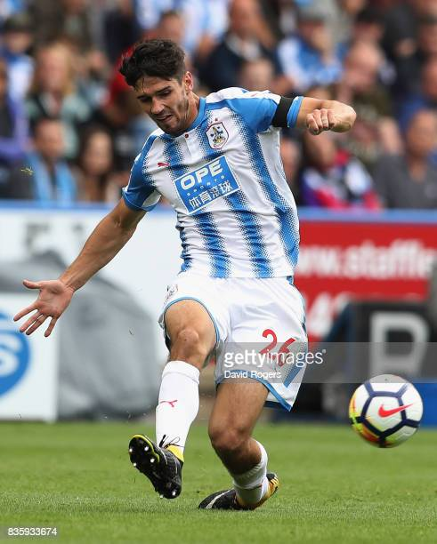 Christopher Schindler of Huddersfield Town passes the ball during the Premier League match between Huddersfield Town and Newcastle United at John...