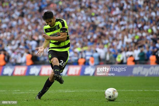 Christopher Schindler of Huddersfield Town scores the winning penalty during the penalty shoot out during the Sky Bet Championship play off final...