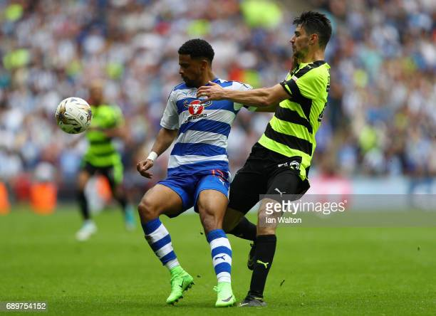 Christopher Schindler of Huddersfield Town tackles Garath McCleary of Reading during the Sky Bet Championship play off final between Huddersfield and...