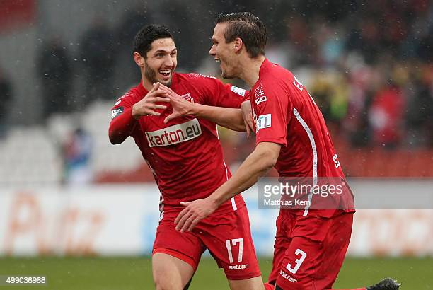 Christopher Schorch of Cottbus jubilates with team mate Fabio Kaufmann after scoring the first goal during the third league match between FC Energie...