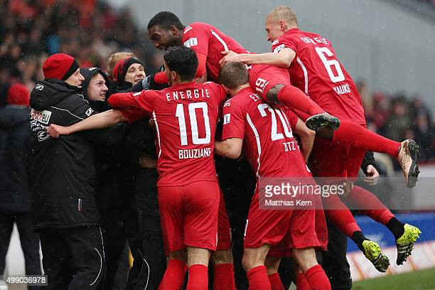 Christopher Schorch of Cottbus jubilates with team mates after scoring the first goal during the third league match between FC Energie Cottbus and RW...