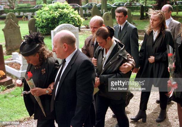 Christopher Scott's grandmother leads his relatives and those of the boys still missing as they arrive for his funeral at St Nicholas Parish Church...
