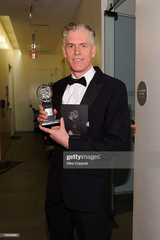 Christopher Shutt poses with the award for Best Sound Design of a Play during the 65th Annual Tony Awards at the The Jewish Community Center in Manhattan on June 12, 2011 in New York City.