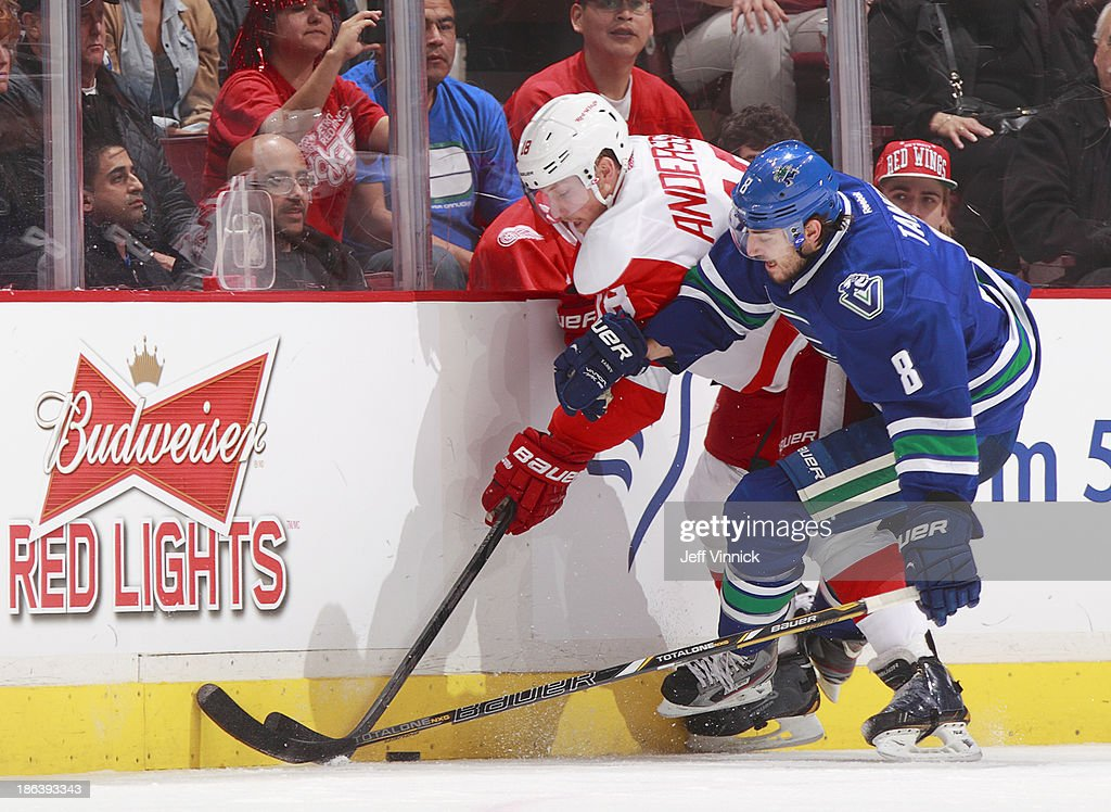 <a gi-track='captionPersonalityLinkClicked' href=/galleries/search?phrase=Christopher+Tanev&family=editorial&specificpeople=7228624 ng-click='$event.stopPropagation()'>Christopher Tanev</a> #8 of the Vancouver Canucks and Joakim Andersson #18 of the Detroit Red Wings battle for the puck during their NHL game at Rogers Arena on October 30, 2013 in Vancouver, British Columbia, Canada.