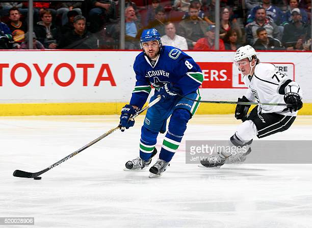 Christopher Tanev of the Vancouver Canucks and Tanner Pearson of the Los Angeles Kings skate up ice during their NHL game at Rogers Arena April 4...