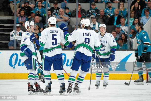 Christopher Tanev of the Vancouver Canucks celebrates his goal in the third period with teammates during a NHL game against the San Jose Sharks at...