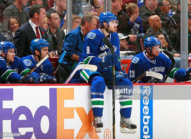 Christopher Tanev of the Vancouver Canucks looks on from the bench during their NHL game against the Toronto Maple Leafs at Rogers Arena on November...