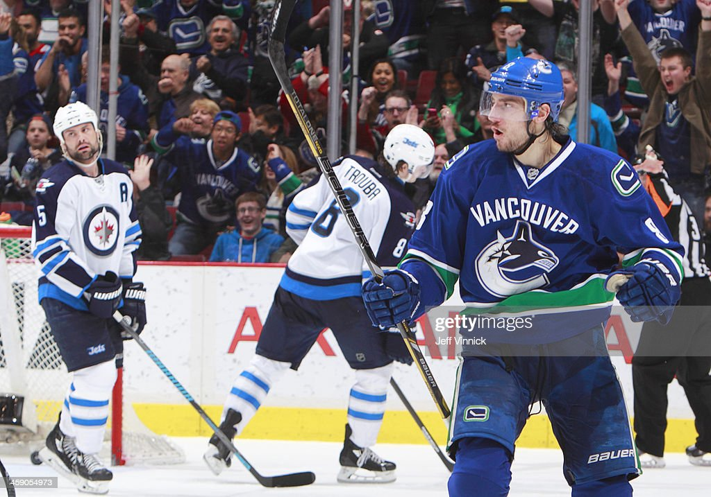<a gi-track='captionPersonalityLinkClicked' href=/galleries/search?phrase=Christopher+Tanev&family=editorial&specificpeople=7228624 ng-click='$event.stopPropagation()'>Christopher Tanev</a> #8 of the Vancouver Canucks reacts after scoring while Mark Stuart #5 and <a gi-track='captionPersonalityLinkClicked' href=/galleries/search?phrase=Jacob+Trouba&family=editorial&specificpeople=8050718 ng-click='$event.stopPropagation()'>Jacob Trouba</a> #8 of the Winnipeg Jets turn away during their NHL game at Rogers Arena December 22, 2013 in Vancouver, British Columbia, Canada. Vancouver won 2-1.