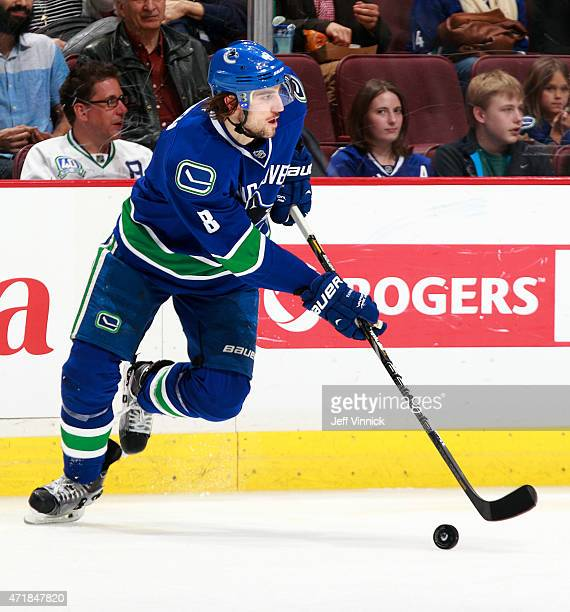 Christopher Tanev of the Vancouver Canucks skates up ice with the puck during their NHL game against the Arizona Coyotes at Rogers Arena April 9 2015...