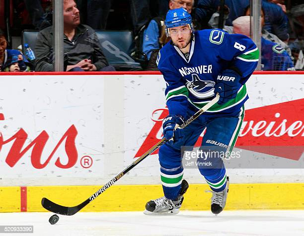 Christopher Tanev of the Vancouver Canucks skates up ice with the puck during their NHL game against the Edmonton Oilers at Rogers Arena April 9 2016...
