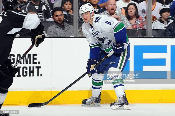 Christopher Tanev of the Vancouver Canucks skates with the puck against the Los Angeles Kings in Game Four of the Western Conference Quarterfinals...