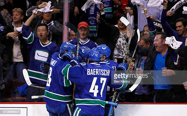 Christopher Tanev Sven Baertschi and Radim Vrbata of the Vancouver Canucks celebrate a goal by teammate Nick Bonino's against the Calgary Flames...