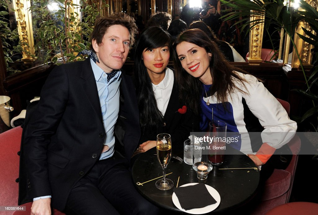 (L to R) Christopher Taylor, guest and Lara Bohinc attend the AnOther Magazine and Dazed & Confused party with Belvedere Vodka at the Cafe Royal hotel on February 18, 2013 in London, England.