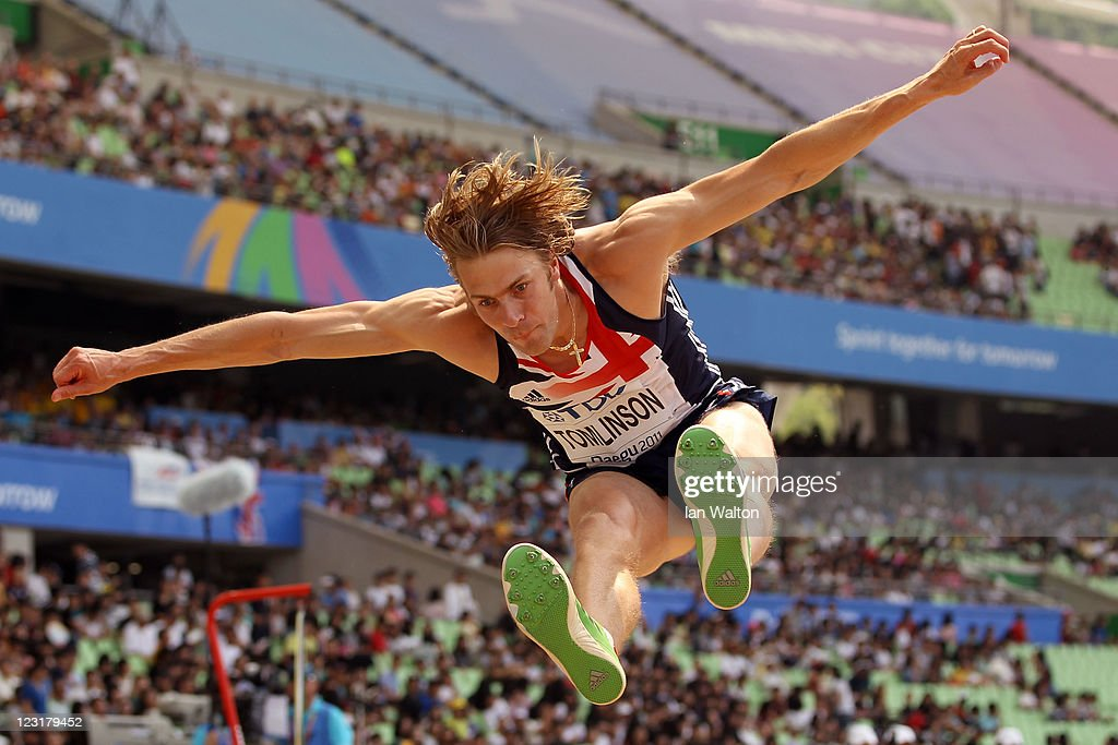 <a gi-track='captionPersonalityLinkClicked' href=/galleries/search?phrase=Christopher+Tomlinson&family=editorial&specificpeople=795113 ng-click='$event.stopPropagation()'>Christopher Tomlinson</a> of Great Britain competes in the men's long jump qualification round during day six of the 13th IAAF World Athletics Championships at the Daegu Stadium on September 1, 2011 in Daegu, South Korea.