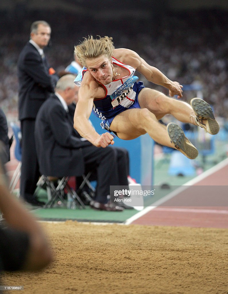 <a gi-track='captionPersonalityLinkClicked' href=/galleries/search?phrase=Christopher+Tomlinson&family=editorial&specificpeople=795113 ng-click='$event.stopPropagation()'>Christopher Tomlinson</a> of Great Britain in the men's long jump final at Olympic Stadium at the Athens 2004 Olympic Games in Athens, Greece on August 26, 2004.